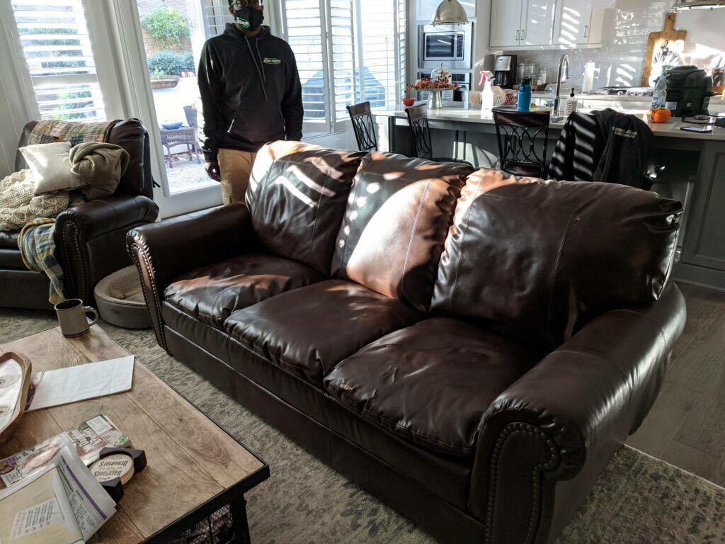 Leather couch removal and donation in Dawsonville, Georgia. - Before Photo
