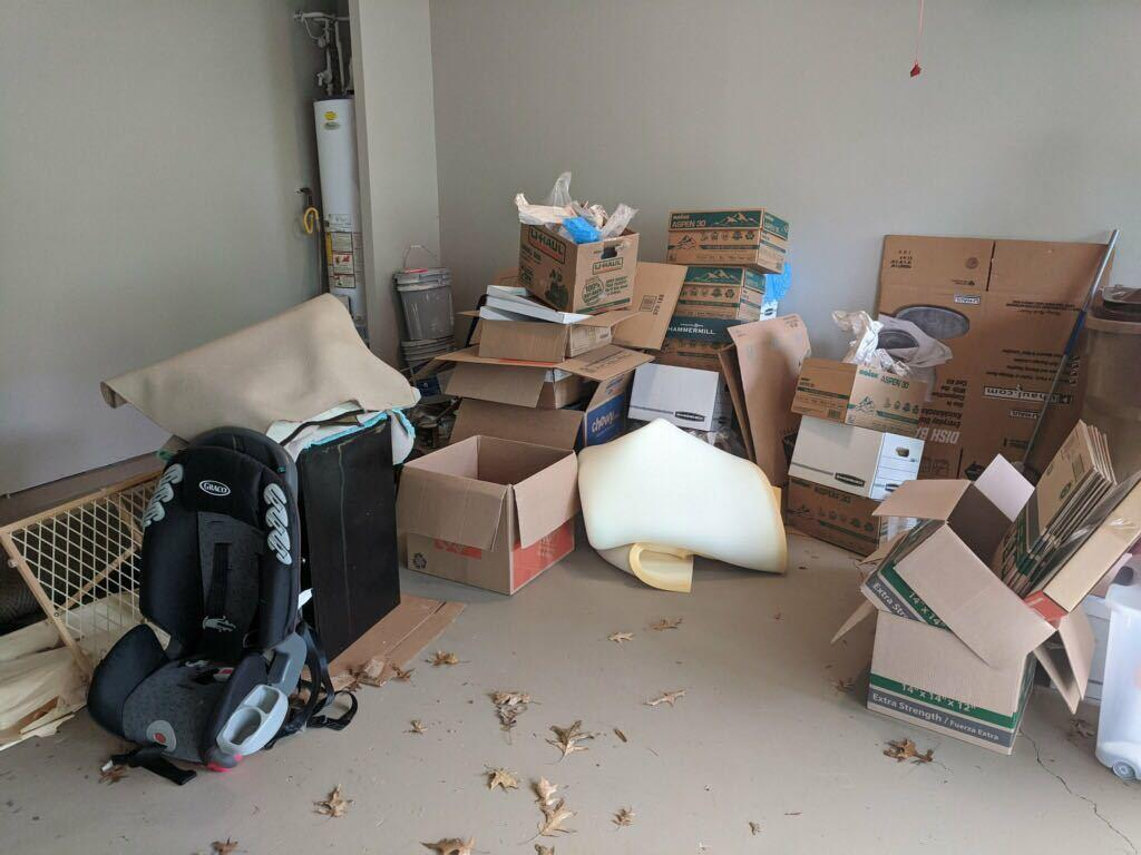 Post move boxes and packing material removal in Dawsonville, GA - Before Photo