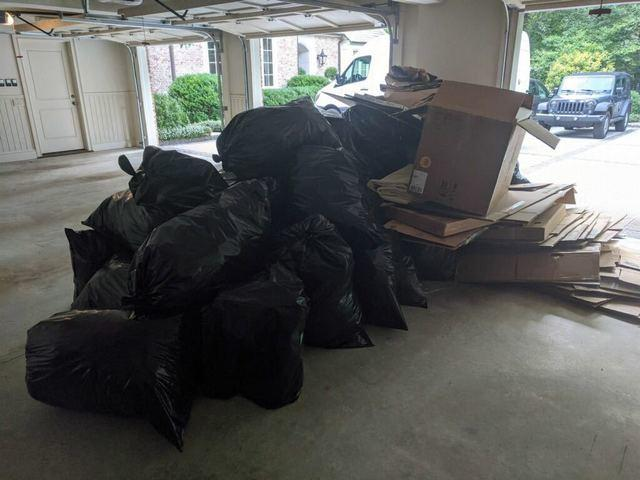 Trash bags and cardboard boxes removed after move in Milton, GA