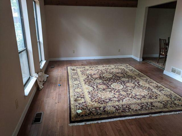 Living room furniture removal in Cumming, Georgia.