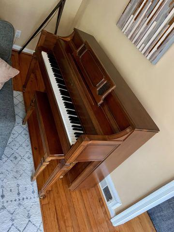 Upright piano removal in Marietta, Georgia.
