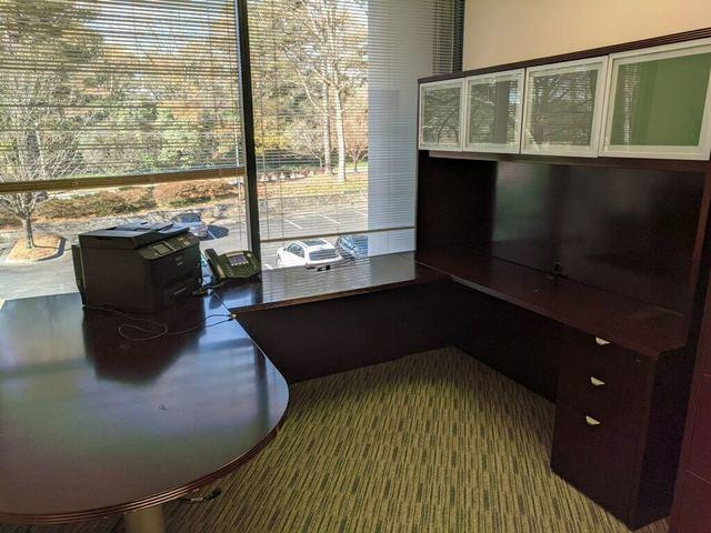 Office desk removal in Alpharetta, Georgia.