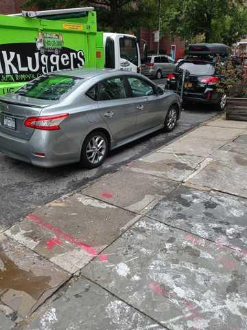 Curb-side clean up on Monroe Street