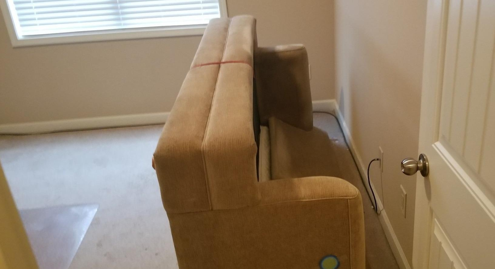 Sofa Removed for a Home in Wake Forest, NC - Before Photo