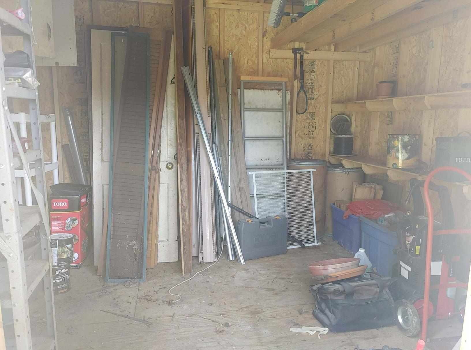 Need your old shed cleaned out and swept up?! Call the JunkLuggers! - Before Photo