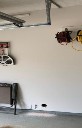 Garage Radon Vent Pipe - Portage, MI - Before Photo