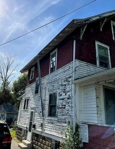 Double Home Gutter Replacement in Brookfield, Ohio - Before Photo