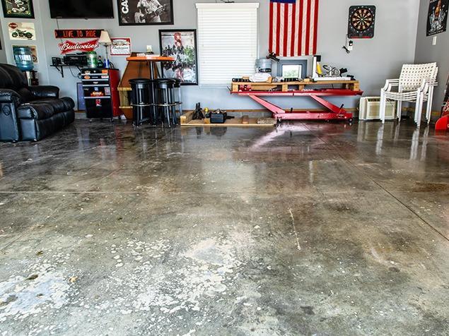 Old Epoxy Garage Floor Transformed in Plattsmouth, NE - Before Photo