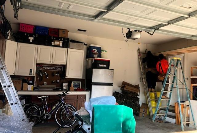 FLOATING SHELVES IN GARAGE FOR EXTRA STORAGE IN SEVERN MD 21144 - Before Photo