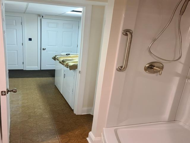 Conversion of an unfinished 1/2 bath basement to finished full bath basement - After Photo