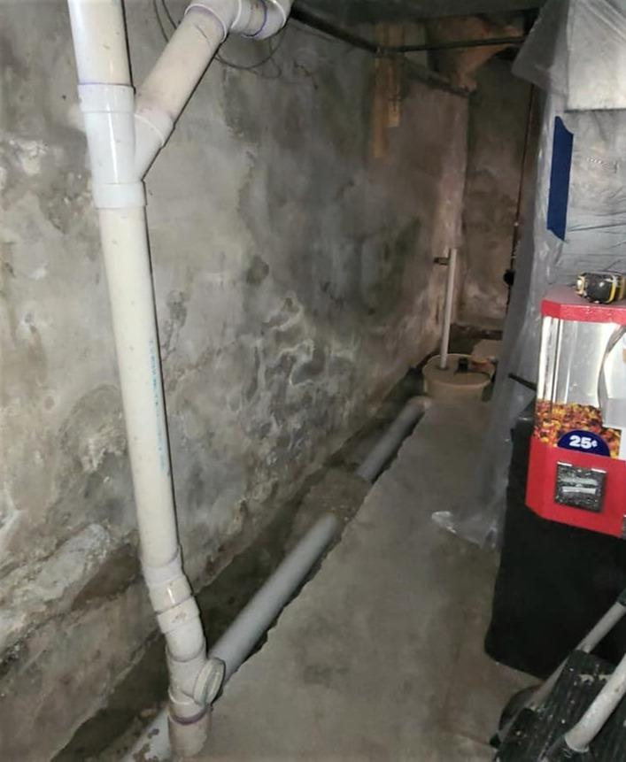 Sump Pump and Drainage System Waterproofs Basement in Ecorse, MI - Before Photo