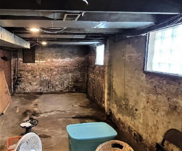 Wet, Musty Basement in Detroit, MI Gets Waterproofing Makeover