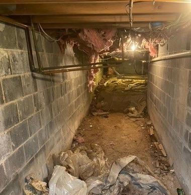 Removing Junk from a Crawlspace Near Lake City, TN