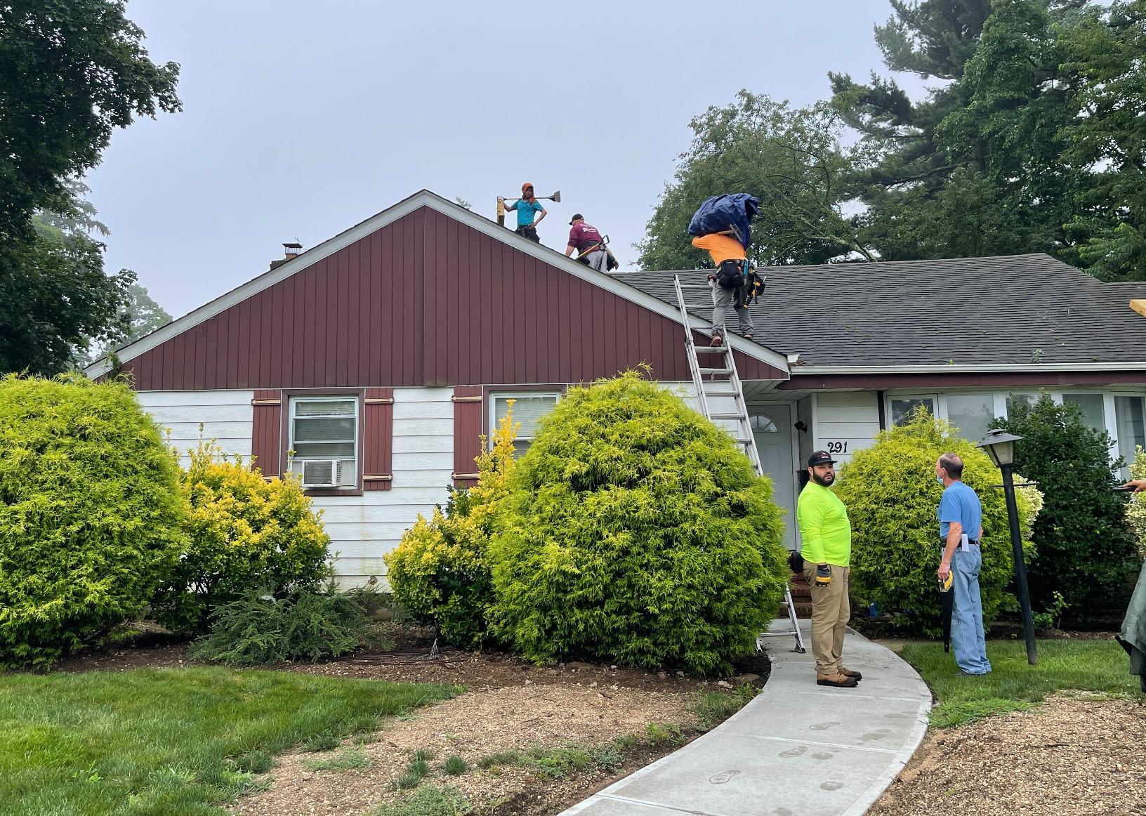 Roof Replacement in Roosevelt, NY - Before Photo