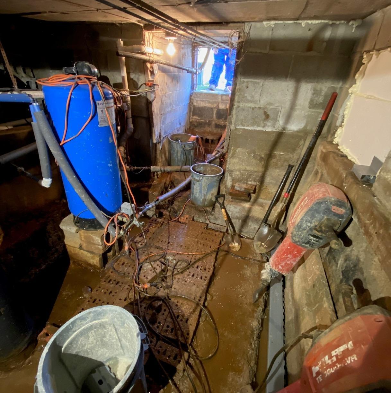 Leonard, MI Basement Waterproofing System - Before Photo