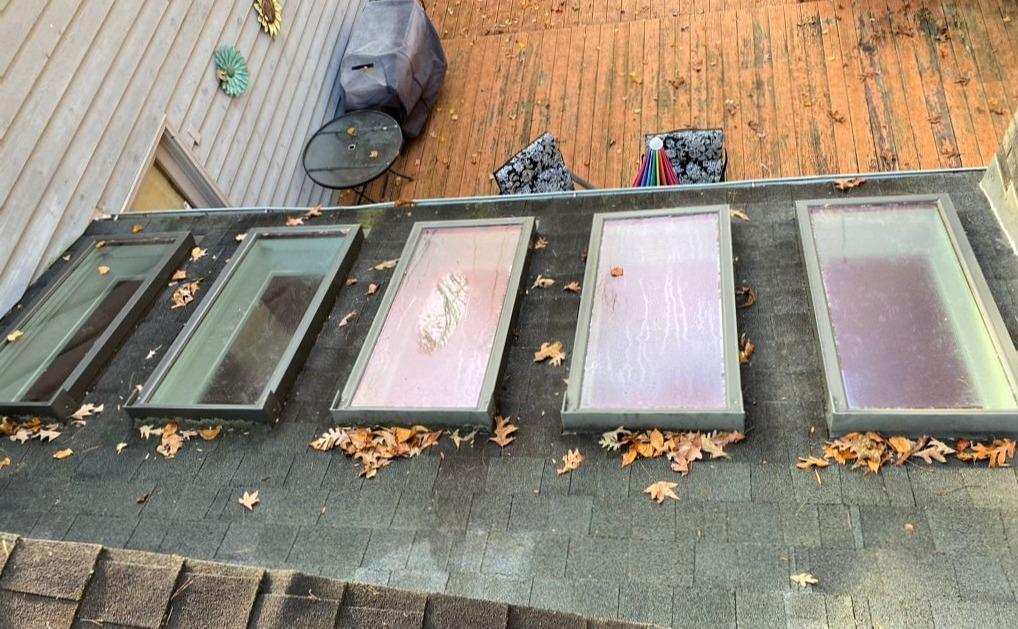 Replacing Rotten Roof Around Skylights in Gibsonville, NC - Before Photo