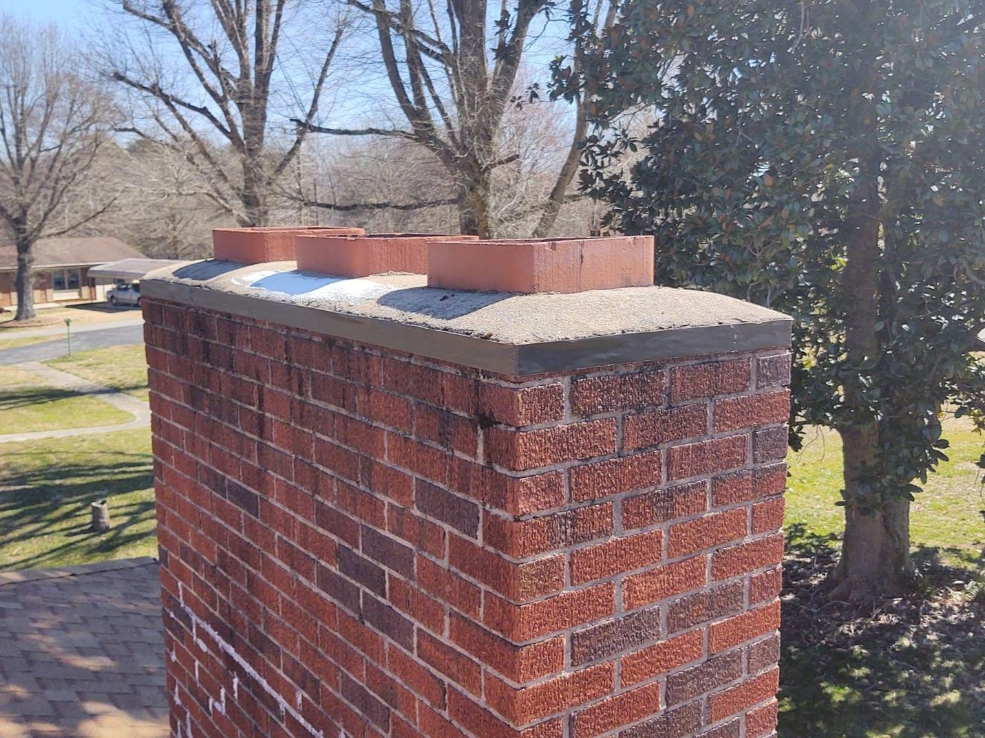 Repairing Old Chimney Sealant and Chimney Cap in Stoneville, NC - Before Photo