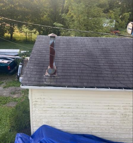 Loveland Garage Roof Replacement Before and After