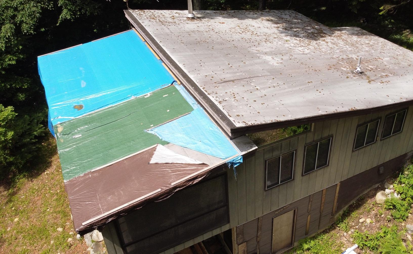 Klaus Flat Roof Replacement in Otis, MA - Before Photo