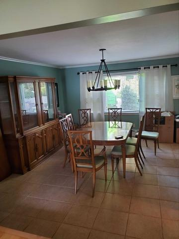 Dining Room Furniture Removal in Glen Cove, NY - Before Photo