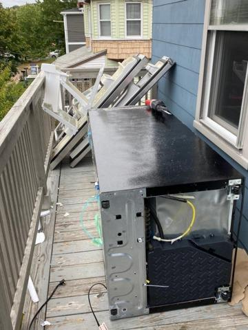 Tricky upstairs fridge removal in Medford, MA