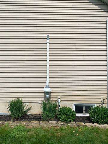 170 Lee Dr, Kouts, IN outside fan and pipe - After Photo