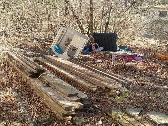Old lumber, playground equipment, etc. removed from behind the garage in Franklin, TN