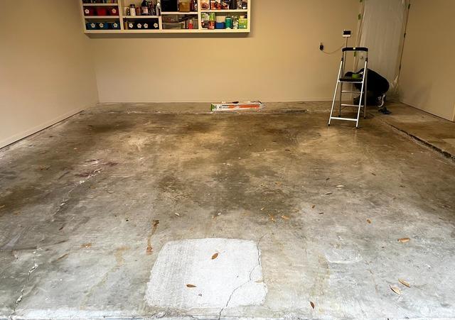Garage flooring complete renovation in Houston, TX - Before Photo