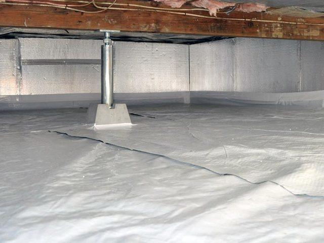 Crawl space support jacks installed in a sealed crawl space.