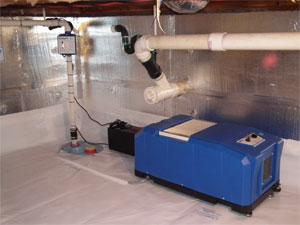 SaniDry CX Dehumidifier installed next to sump system