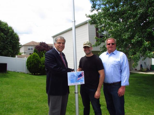 Mayor Fred with Yolvis and Tom Roman