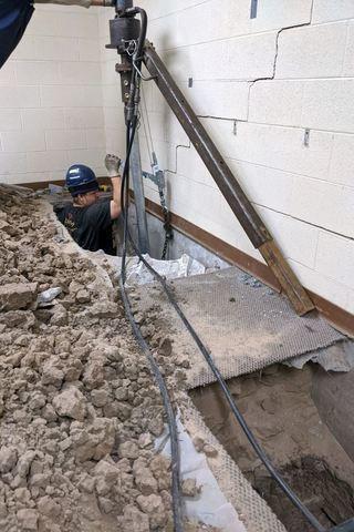 Floor dug up to insert helicals in CCC building