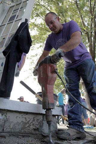 Thrasher Volunteering jackhammering in Council Bluffs