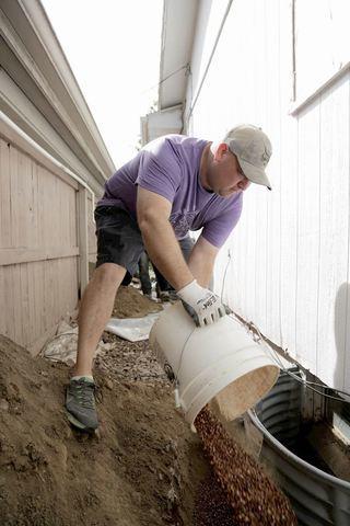 Brad Volunteer Dump Gravel into Egress