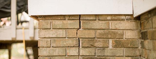 stair step brick wall crack