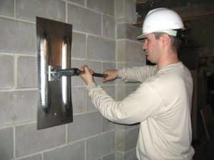 tightening the wall anchors