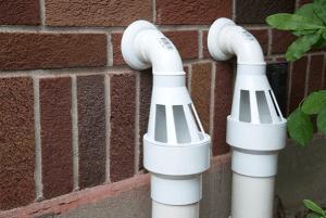 prevent sump pump discharge line clogs