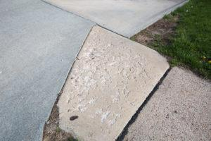 cracked driveway and pitted concrete
