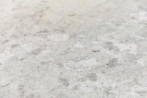 pitted flaking concrete closeup