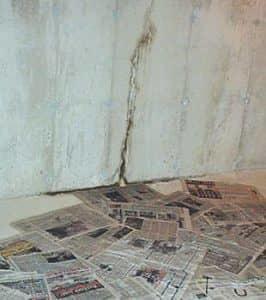 newspapers stuck to a concert basement floor