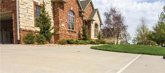 Brick homes with nice concrete driveway