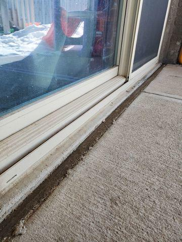 Melted Snow Water on patio collecting by sliding door