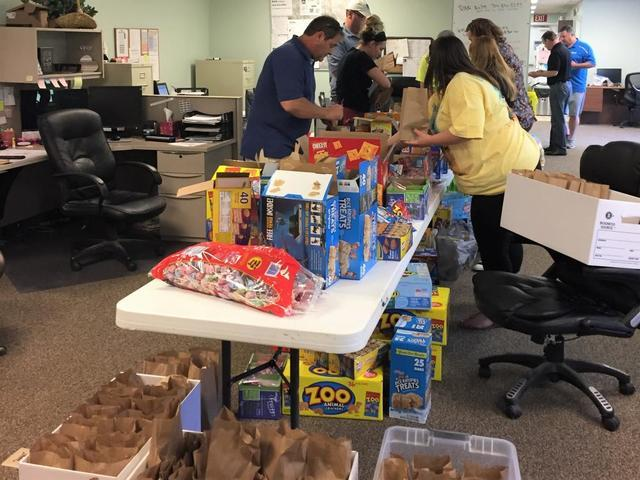 Baker's Waterproofing hosted an event to prepare breakfast and snack bags for children and their families residing at the Ronald...