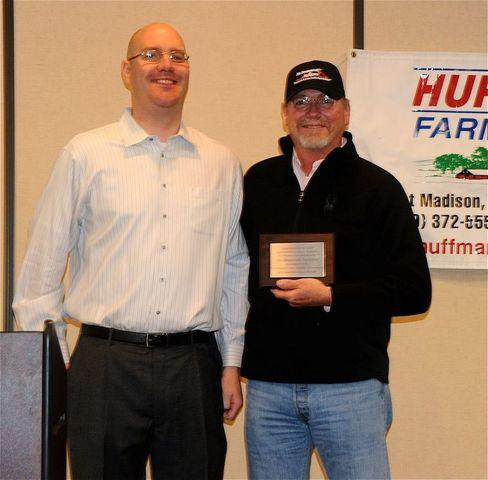 Fort Madison Chamber of Commerce Board of Directors Chairman Justin Pieper, left, awards Kevin Brown of Bix Basement Systems the...
