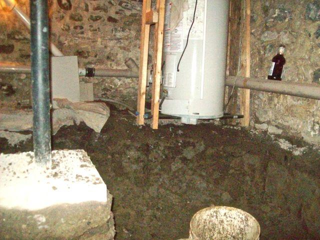 View of secured piping and tanks, while flooring is excavated
