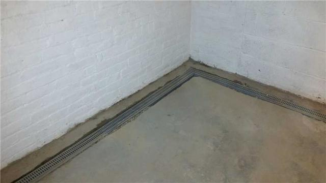 The TrenchDrain is located around the basement to allow water to flow through.