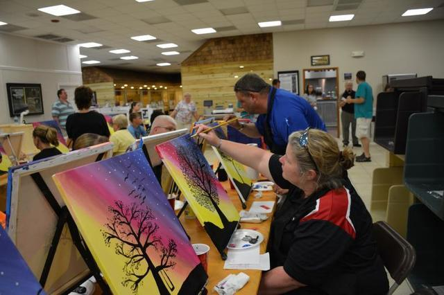 Heather and Bill Anderson enjoying paint night in their DryZone barn.