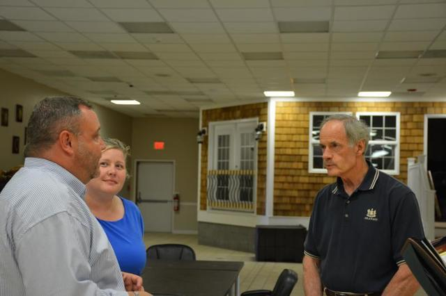 Senator Carper talking to Bill Anderson and Heather Anderson; the owners of DryZone.