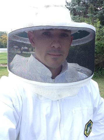 Pest control technician in bee protective suit