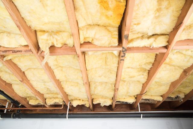 Wet batt insulation between crawl space floor joists